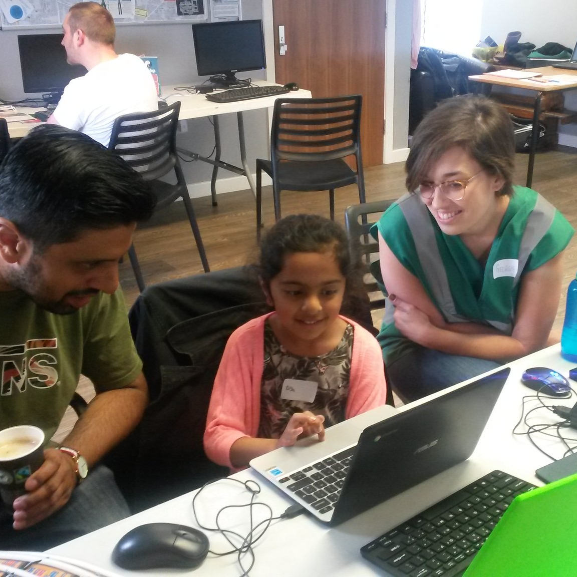 Photograph of a Ninja learning scratch at Tameside CoderDojo, with our mentor Georgie